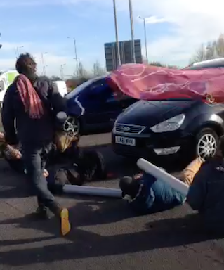 protesters-blocking-road-at-lights