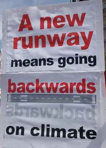 Going backwards placard