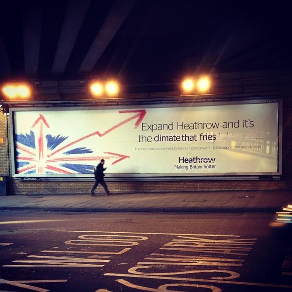 Heathrow roadside hoarding subvertised Nov 2014